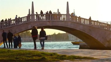 Venice, Italy - October 2017: People walk along the pedestrian bridge across the Gran Canal in Venice Italy