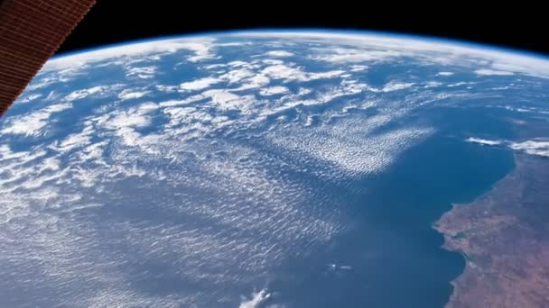 A flight over the earth's surface, taken from a space station. Elements Of This Video Furnished By Nasa.