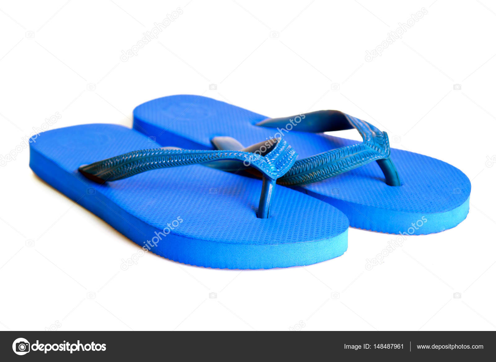 d031d280a9e Rubber embed with plastic sandal or slipper product with black and yellow  stripes isolated on white — Photo by SuradechK