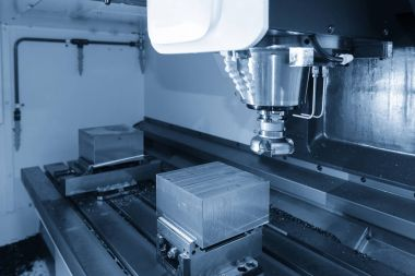 The CNC milling machine cutting the raw material