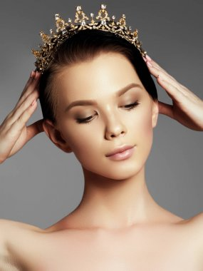 Fashion gorgeous woman in diamond crown, beauty contest winner. Luxury girl with bright makeup