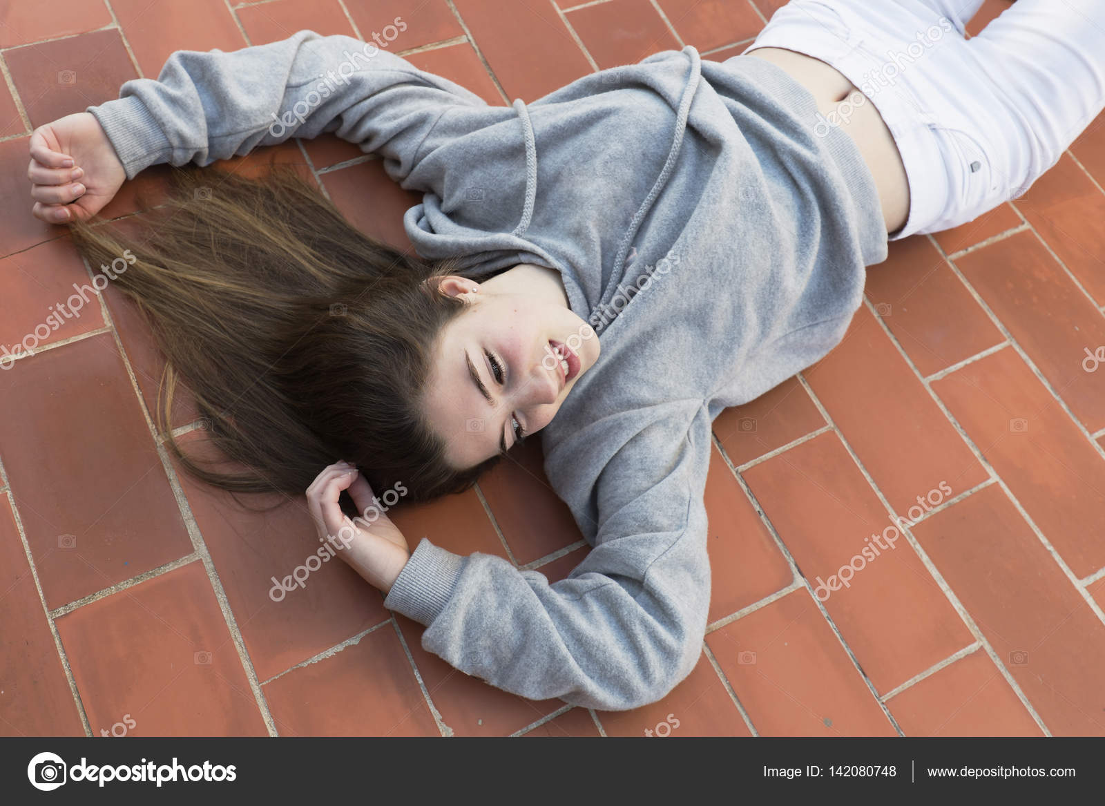 Young woman lying on laid floor