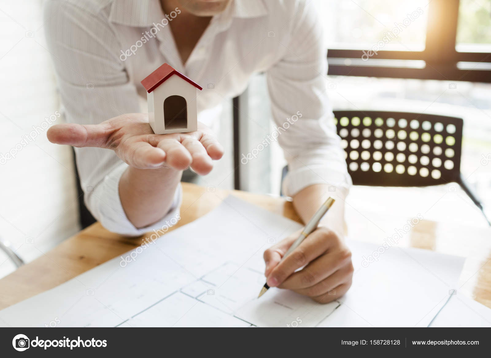 Business architect engineer drawing a house blueprint planning t business architect engineer drawing a house blueprint planning to build a new home at housing estate development project photo by panubestphoto malvernweather Choice Image