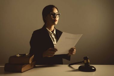 Female lawyers are sitting at the table, vintage.