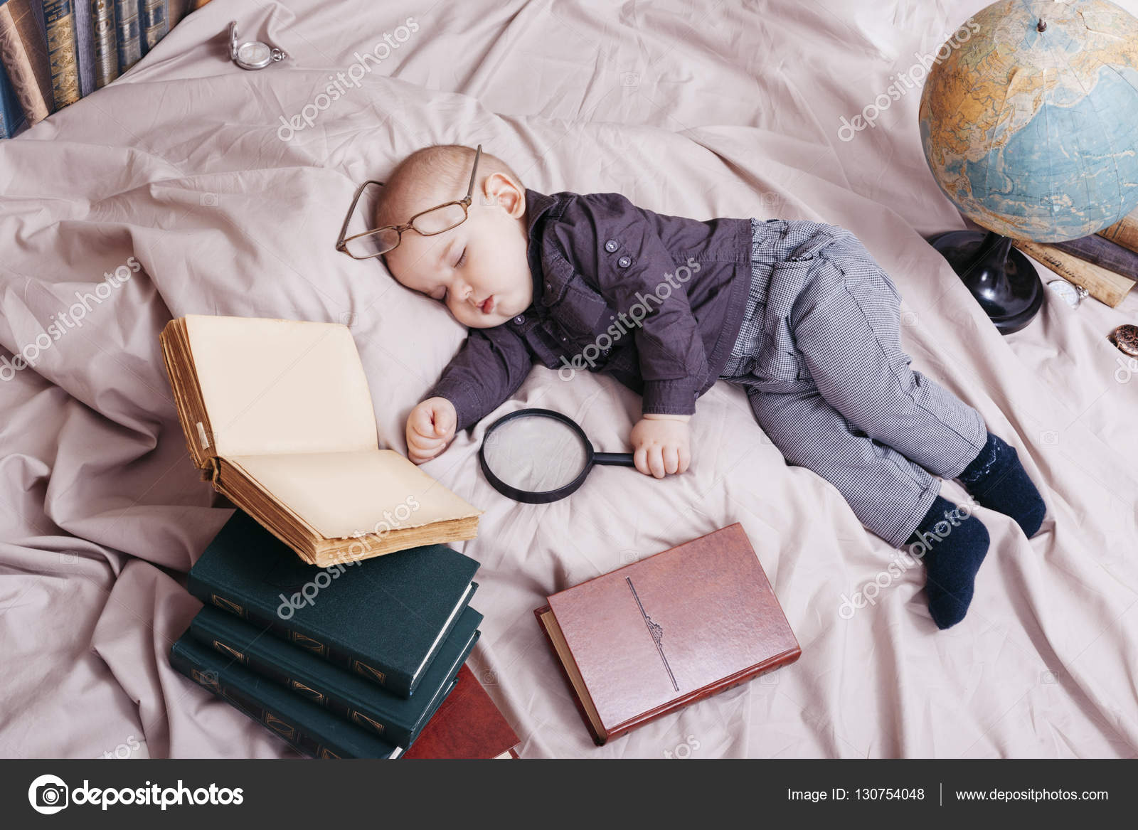 Funny Sleeping Baby In Glasses With Books And Globe Layout Stock Photo C Aksanat 130754048