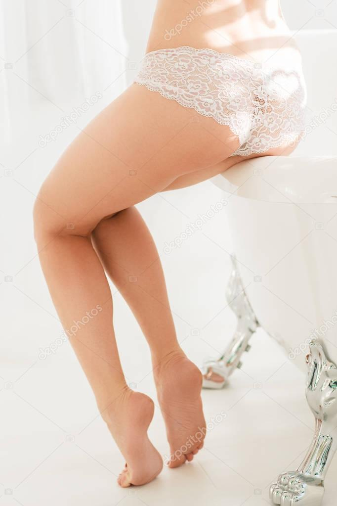 Perfect female legs in bathroom, spa concept