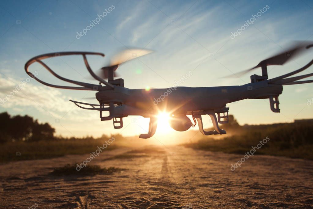 Drone flying on sunset light close-up, free space