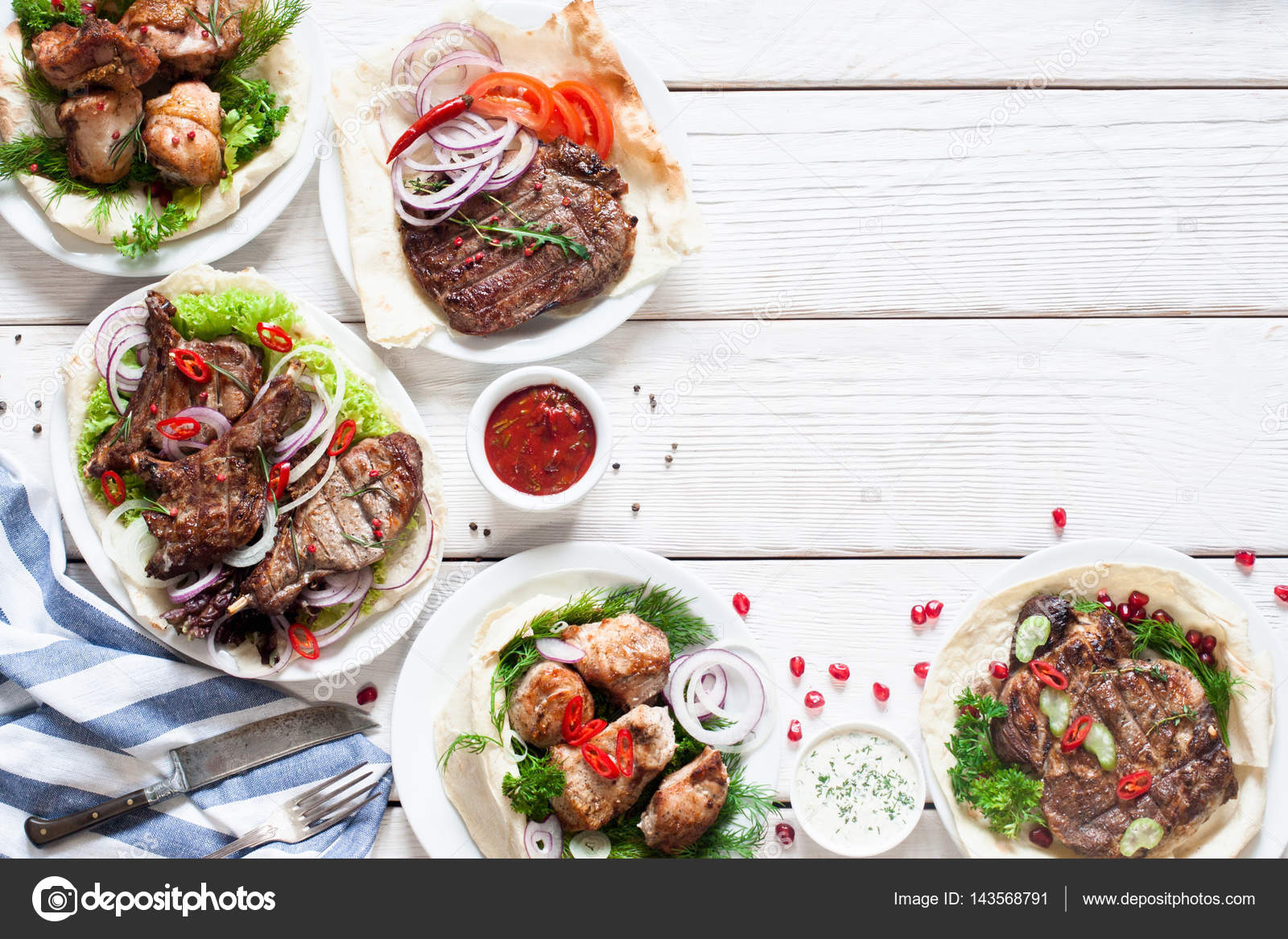 Grilled meat meals on table free space stock photo for Little fish menu