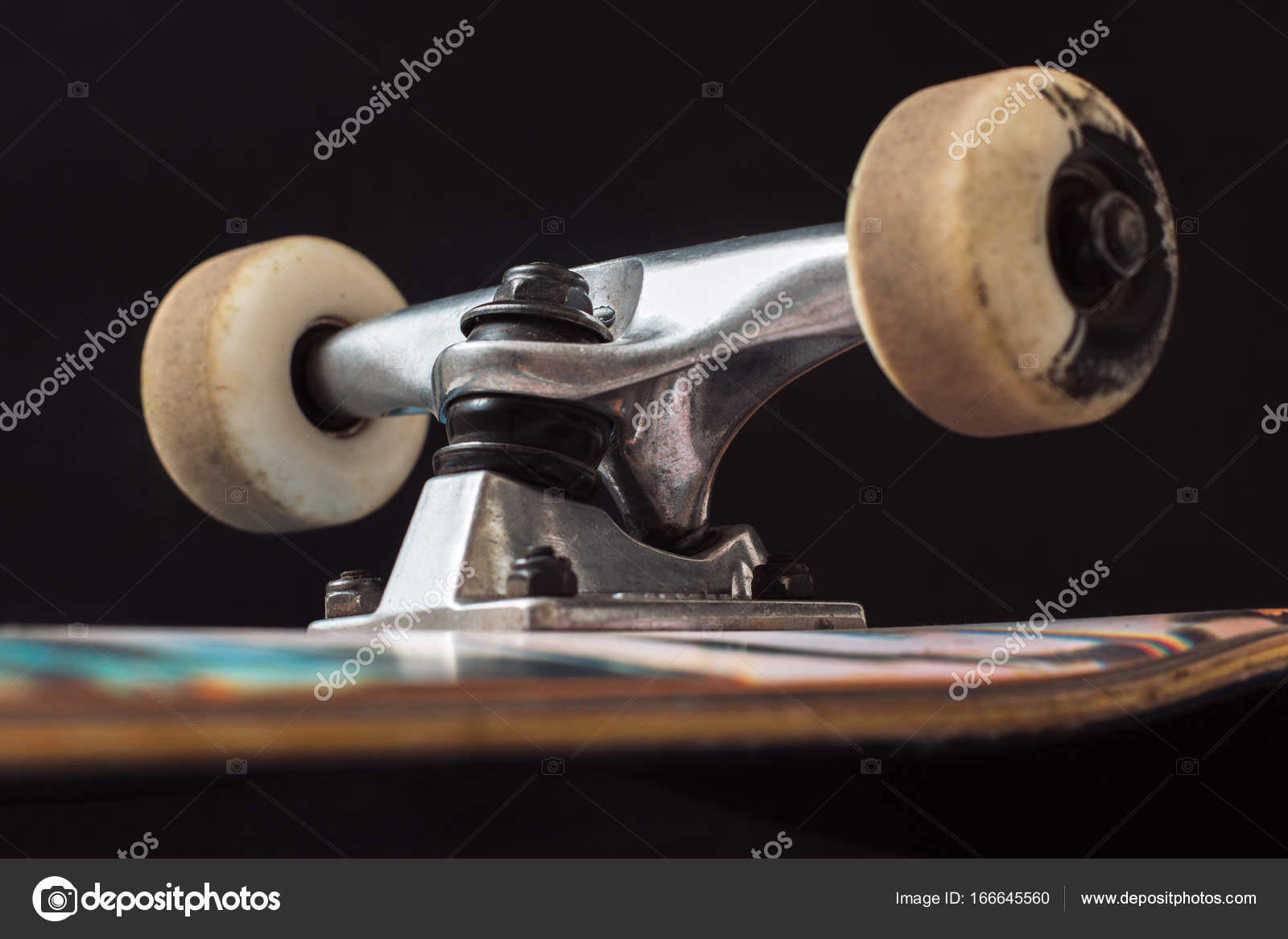 c50a8957 ... up of skateboard truck and wheels on black background. Advertizing  safety construction of professional extreme sport devices and skateboarding  elements.
