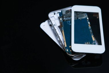 disassembled smartphone gadgets technology