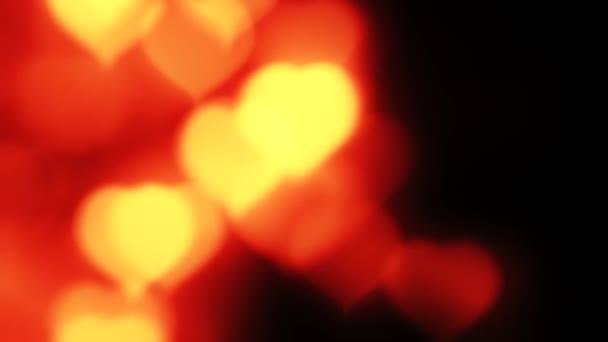 romantic background blur red orange glowing hearts
