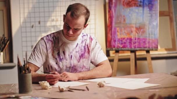 creative block unhappy male artist bad sketches