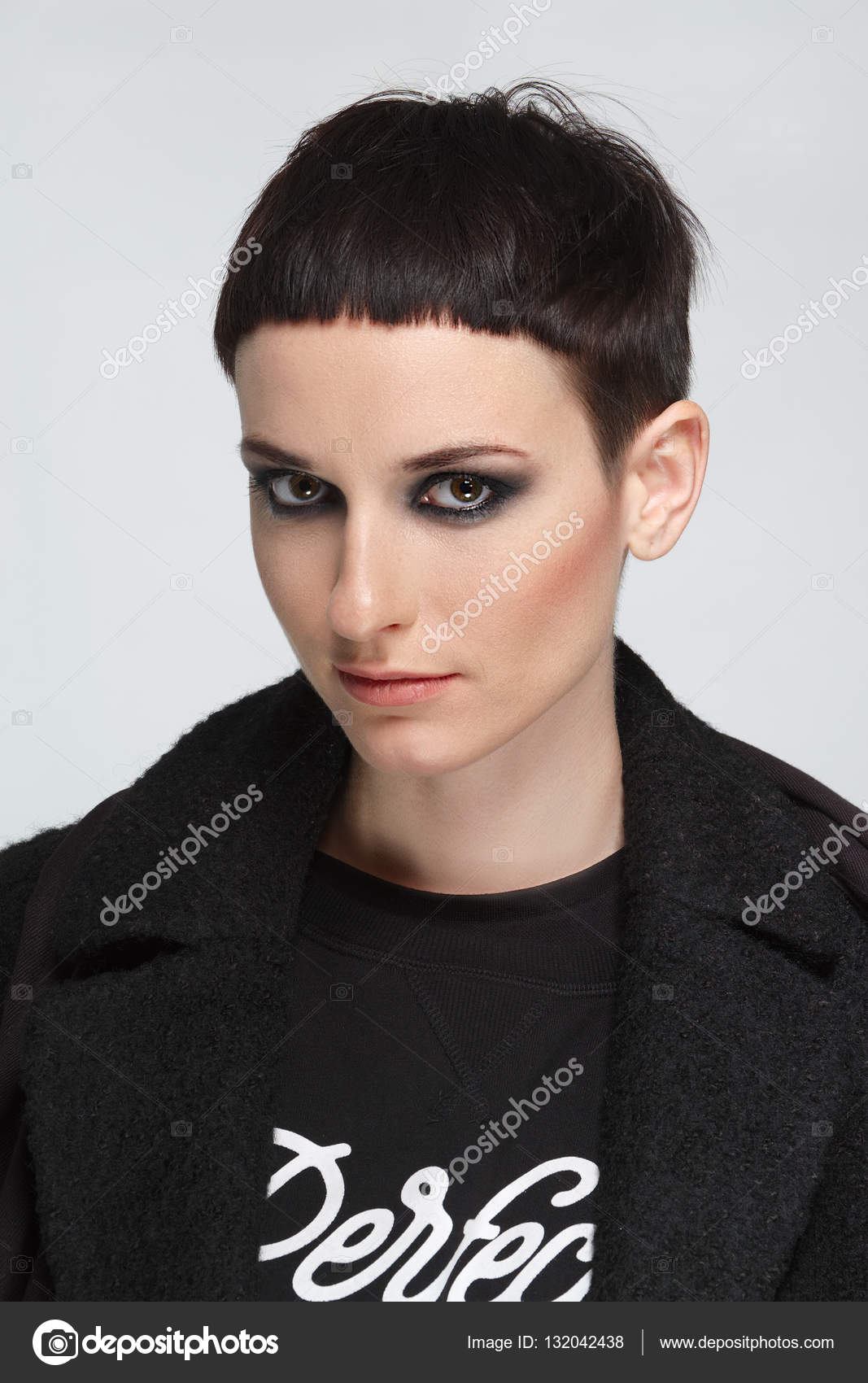 Hairstyles For Black Teenage Girl With Short Natural Hair Pretty Young Woman With Short Black Hair In Black Warm Coat Short Haircut And Style Natural Makeup Stock Photo C Boomeart 132042438
