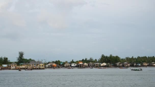 Long-tail boat or tourist vessels through fishing villages in the southern of Thailand.