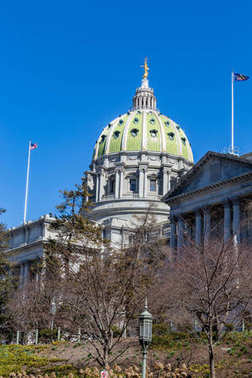 Harrisburg, PA, USA - March 22, 2018: The Pennsylvania State Capitol Building in Harrisburg is easily with recognizable with its distinctive green dome.
