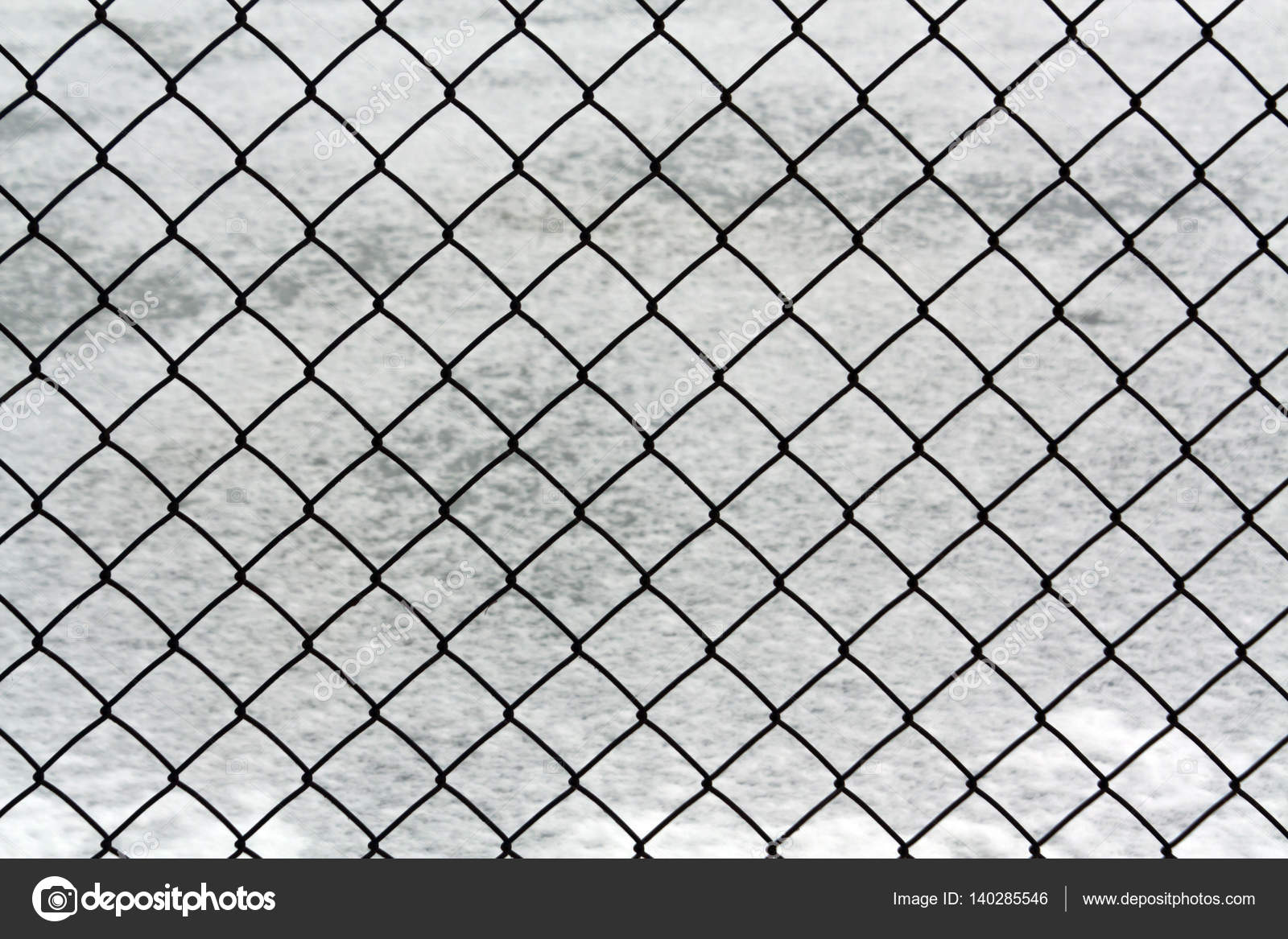 Metal wire mesh fence and snow. — Stock Photo © pavelalexeev #140285546