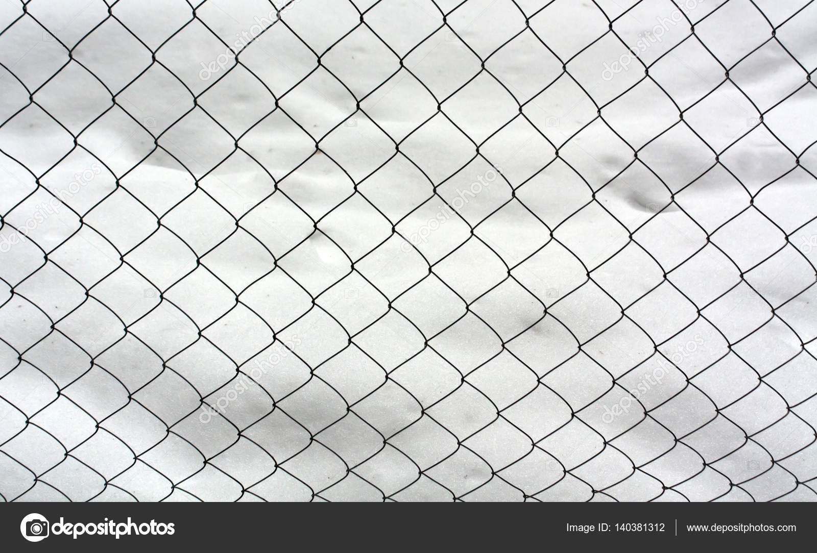 Wire mesh fence and snow. — Stock Photo © pavelalexeev #140381312