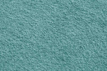 cyan color towel surface close-up with blur effect.