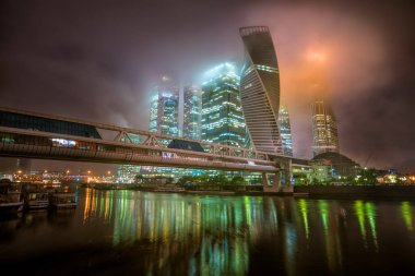 Moscow-city at night in the fog and at low clouds