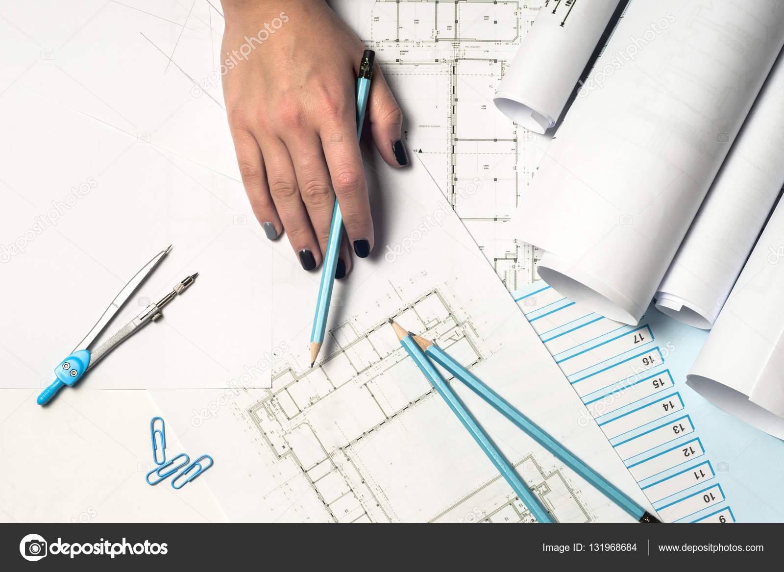 Architect working on blueprint stock photo vtmila 131968684 architects workplace architectural project blueprints ruler and divider compass construction concept engineering tools top view photo by vtmila malvernweather