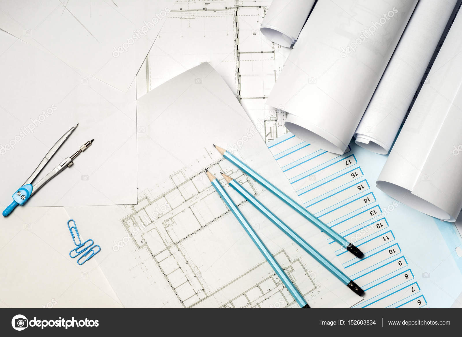 Architect working on blueprint stock photo vtmila 152603834 architects workplace architectural project blueprints ruler and divider compass construction concept engineering tools top view photo by vtmila malvernweather Gallery