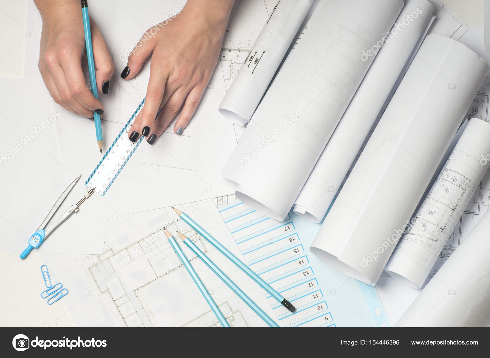 Architect working on blueprint stock photo vtmila 154446396 architects workplace architectural project blueprints ruler and divider compass construction concept engineering tools top view photo by vtmila malvernweather Image collections