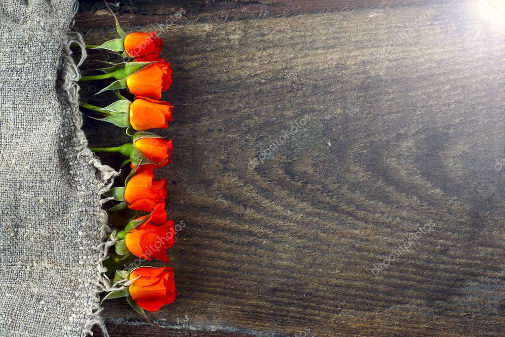 red roses on wooden board, Valentines Day background.