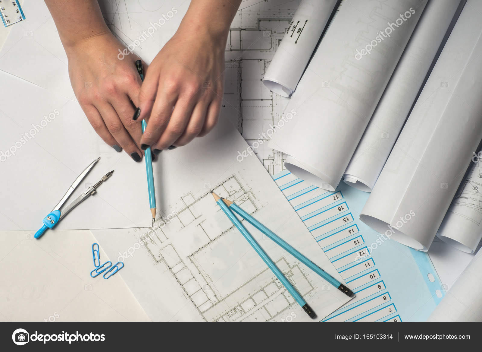 Architect working on blueprint stock photo vtmila 165103314 architects workplace architectural project blueprints ruler and divider compass construction concept engineering tools top view photo by vtmila malvernweather Images