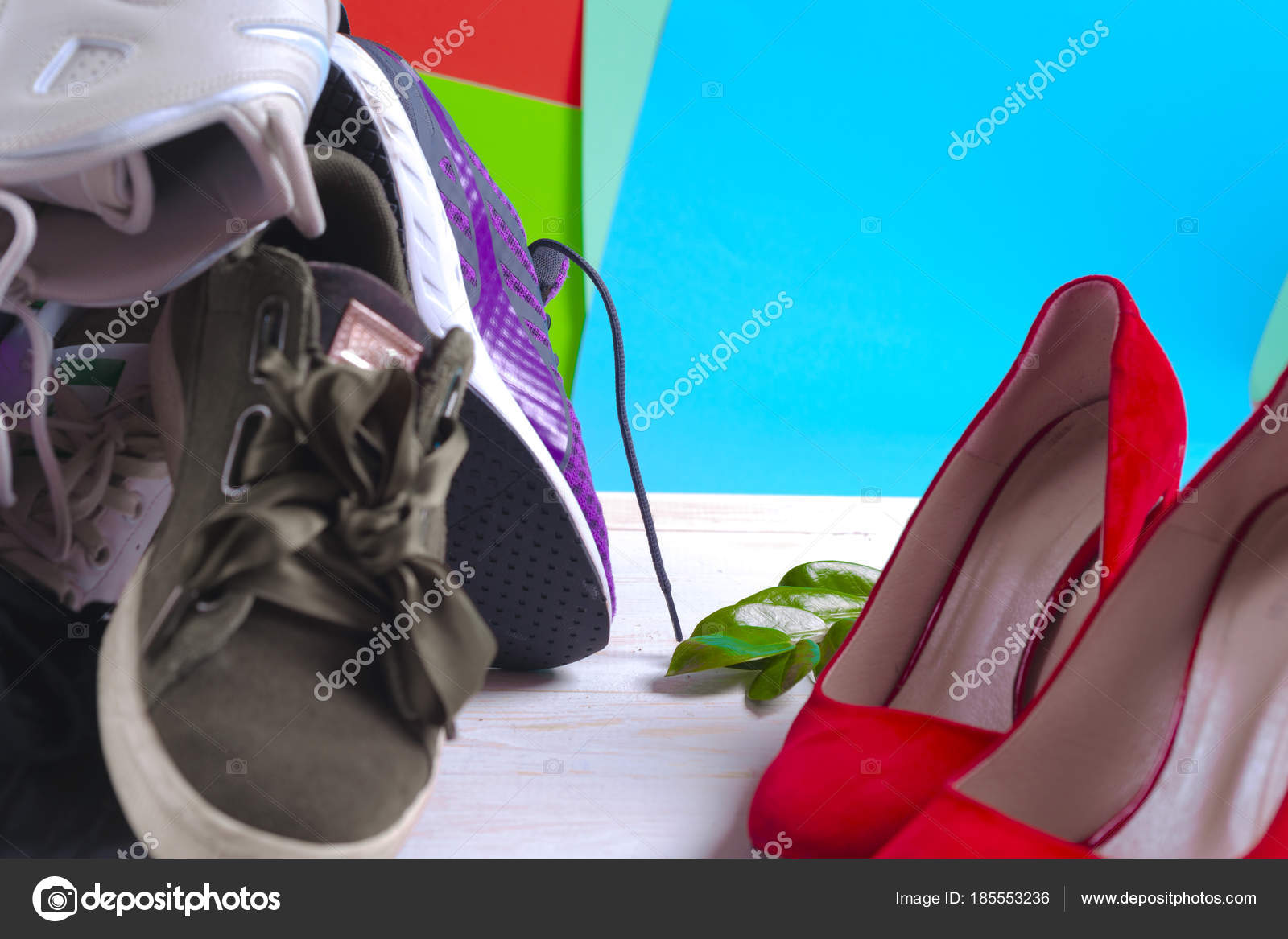 3aa63305f9b5 Big heap of different sports shoes and red high heel womens shoes. Set of  sneakers — Photo by ...