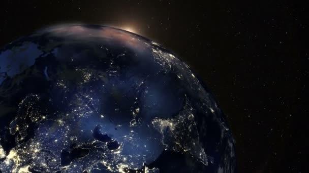 Východ slunce na zemi z vesmíru vidět z vesmíru