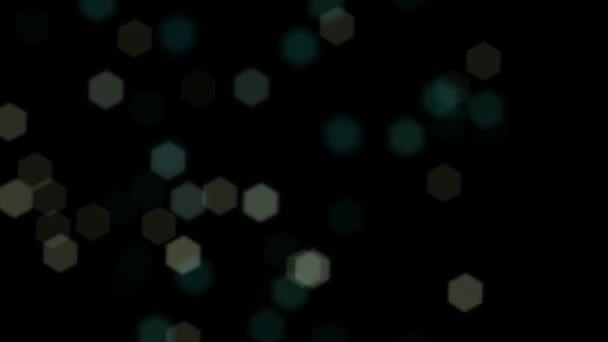 Blinkende Objektiv Sechseck Bokeh herumfliegen auf schwarzem Hintergrund