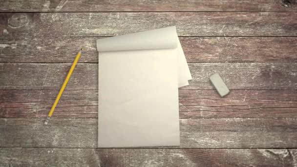 Jegyzetfüzet, ceruza és radír-ban megáll jelet ad