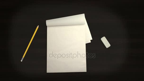 Poznámkový blok tužka a guma na černém pozadí v Stop-Motion