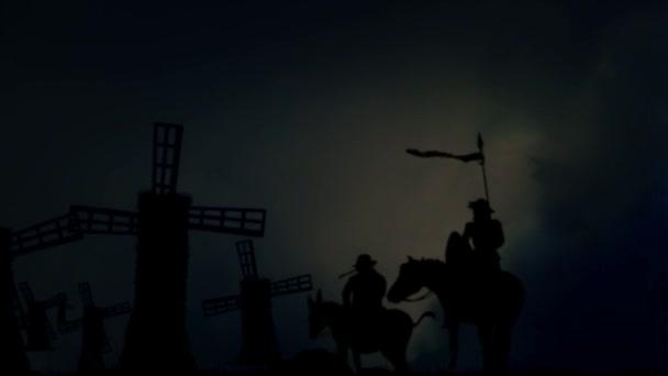 Don Quijote és Sancho Panza álló előtt a szélmalmok Stormy-nap