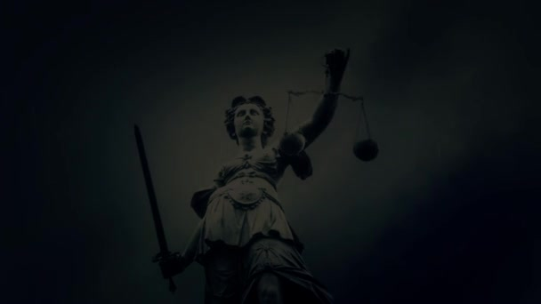 Justice Lady Statue Holding Sword and Scales Under a Rain Storm