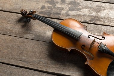 Violin on wooden table, close up view
