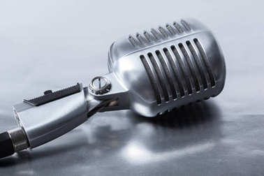 Retro microphone isolated close up