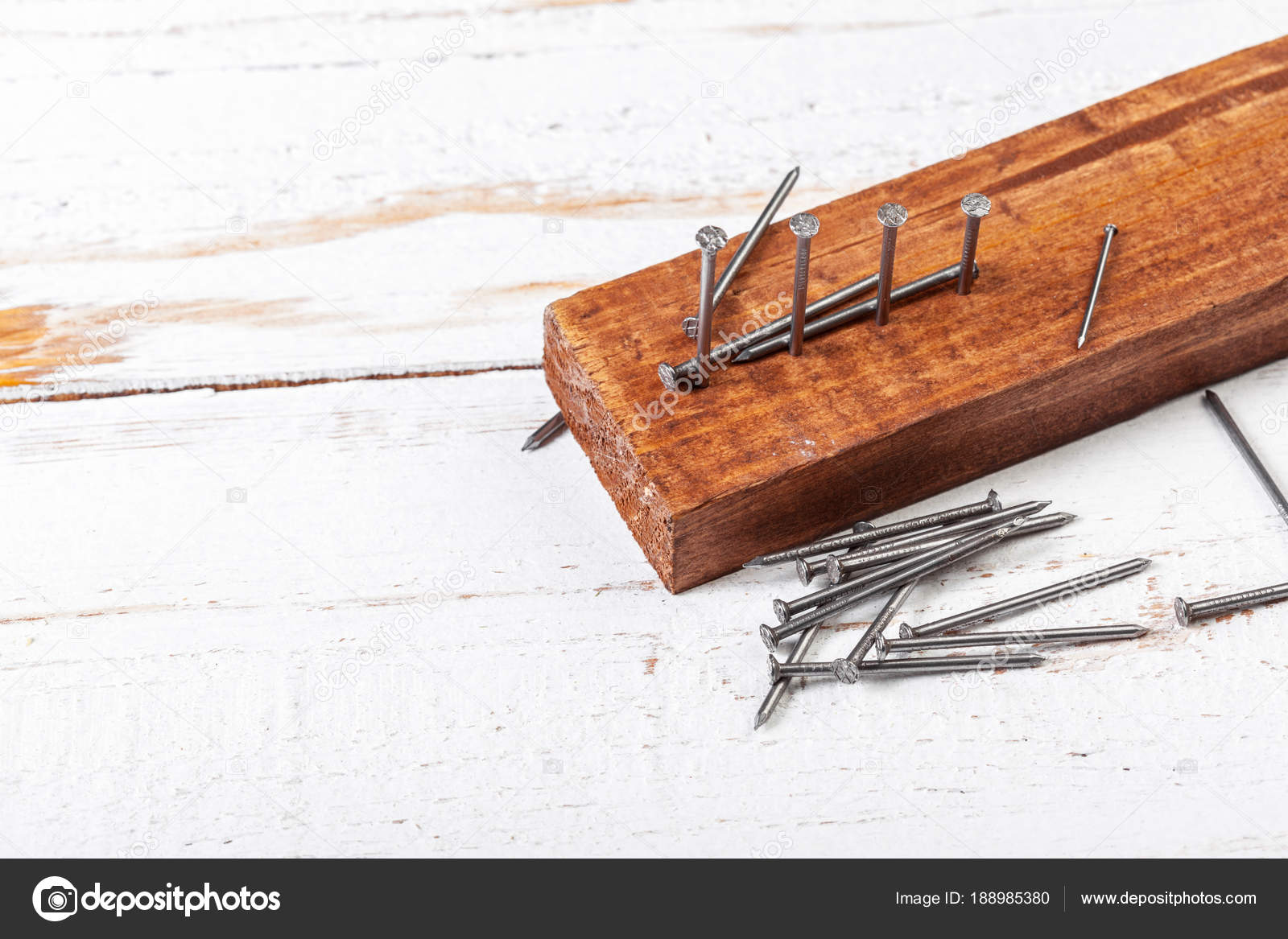 Pile Iron Nails Wooden Table Stock Photo