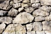 Fotografie Skládané kamenné zdi pozadí