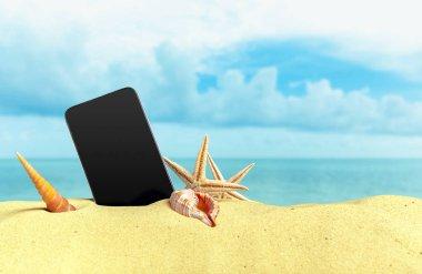 Phone on the sandy beach coast