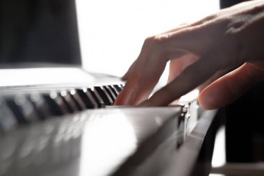 Person Playing Piano. close up
