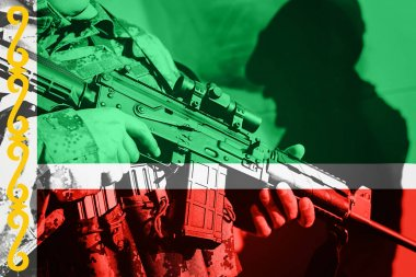 Soldier with machine gun with national flag of Chechnya
