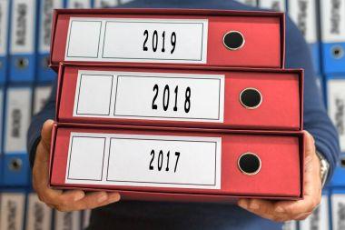 2017, 2018, 2019  concept words. Folder concept. Ring binders.