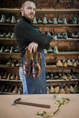 Male shoe maker working