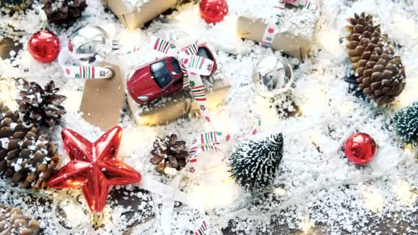christmas and new year background with toy car present with ribbon balls pinecones and