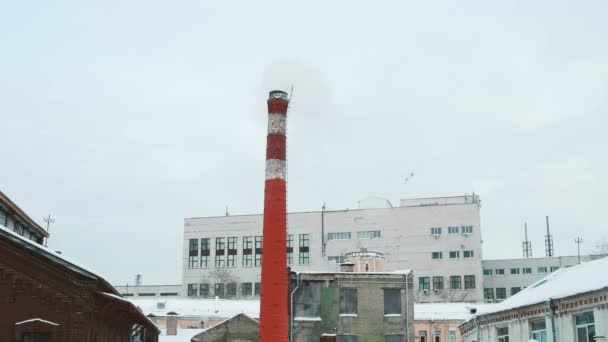 Boiler house chimney. Steam against the cloudy sky. Industrial zone of the city.