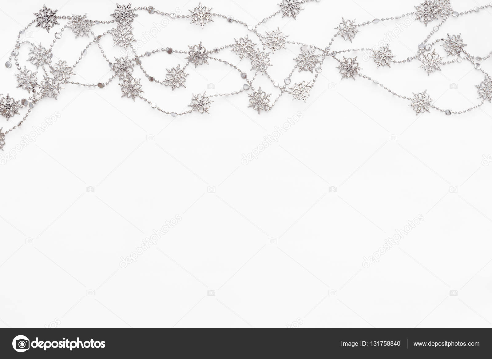clear white background with border of silver chain with snowflakes christmas and new year holiday background with place for text flat lay top view