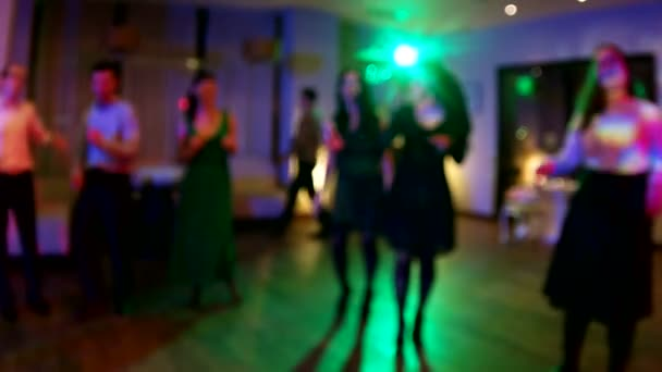 Wedding. Dancing bride and groom, couples and guests. Out of focus slow motion clip.