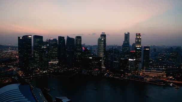 SINGAPORE, SINGAPORE - January 16, 2013. Singapore city at sunset. Skyline at night. Skyscrapers at Marina Bay. Panorama view.