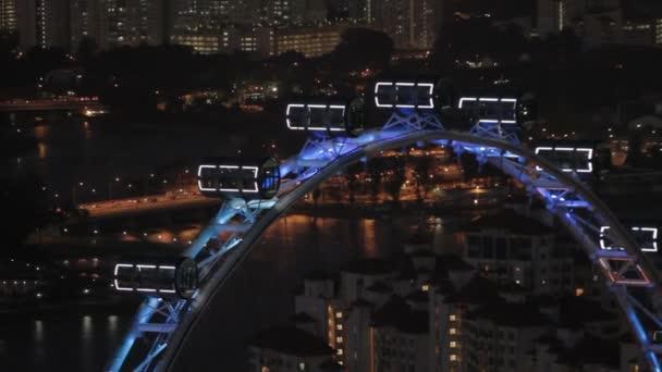 SINGAPORE, SINGAPORE - January 16, 2013. Night cityscape. The Singapore Flyer, a giant Ferris wheel.